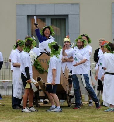 Team smiling and laughing after winning the chariot race