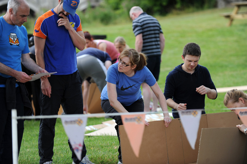 Teams construct their boat for Flat Out Afloat