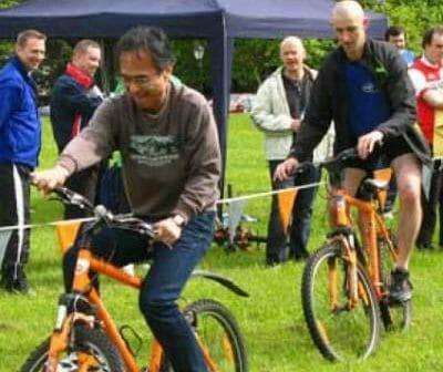Men riding their bikes during one of the team challenges of Corporate Sports Day powered by Orangeworks