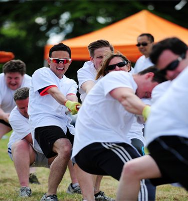 Delegates in the middle of Tug of War challenge during Corporate Sports Day team building