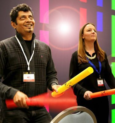 Delegates using their boom whackers to make some music in Boom Time team building event