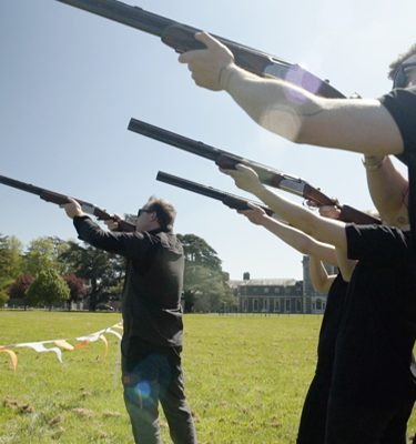 Delegatesd pointing their guns up in the air ready for laser clay pigeon shooting with Orangeworks.