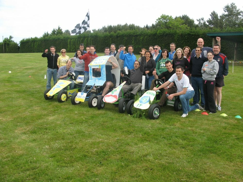 Teams standing in a line with their go-karts in front of them, ready to take on the final race of Thunder Races.
