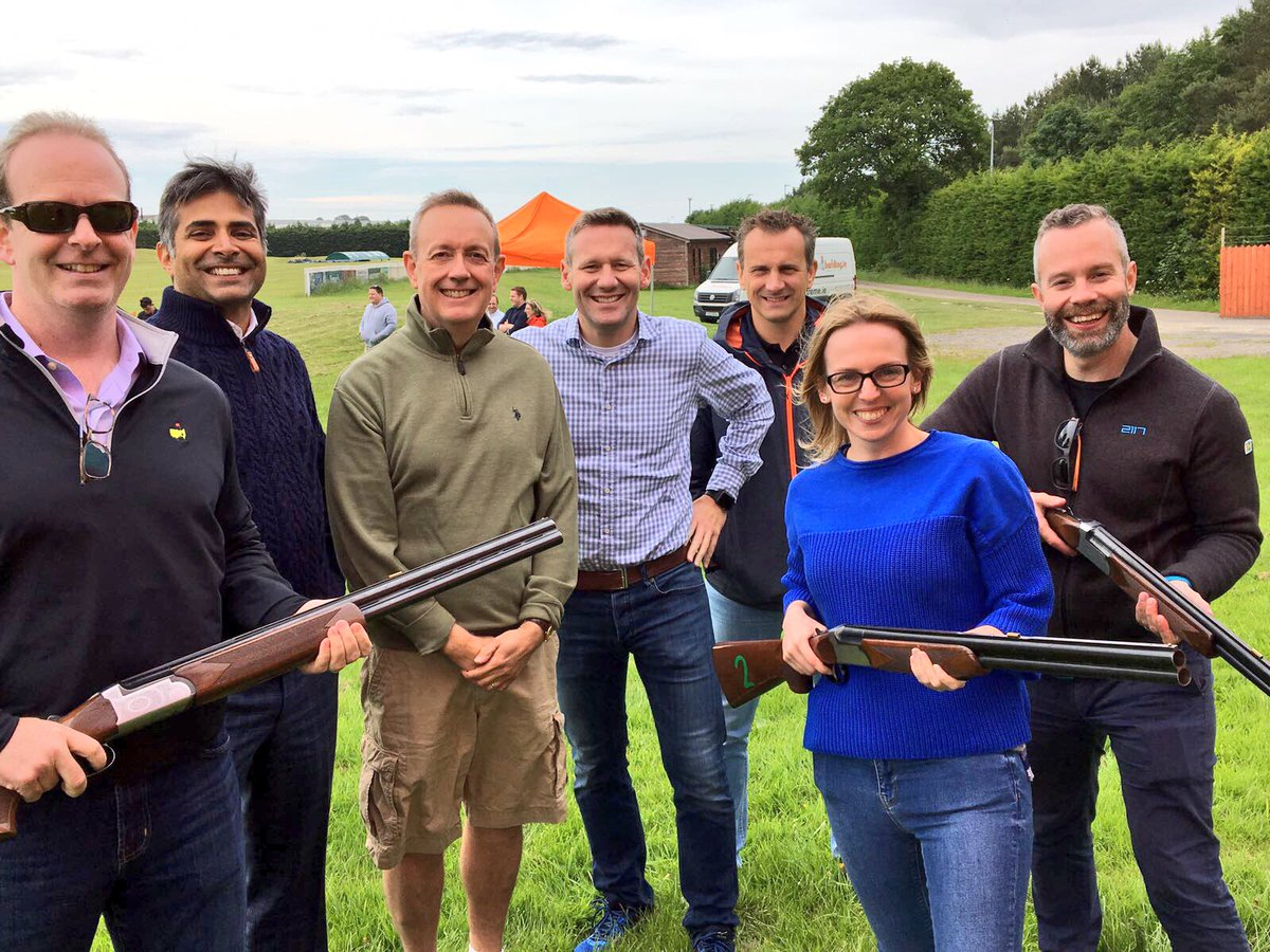 Delegates smiling after playing some laser clay pigeon shooting