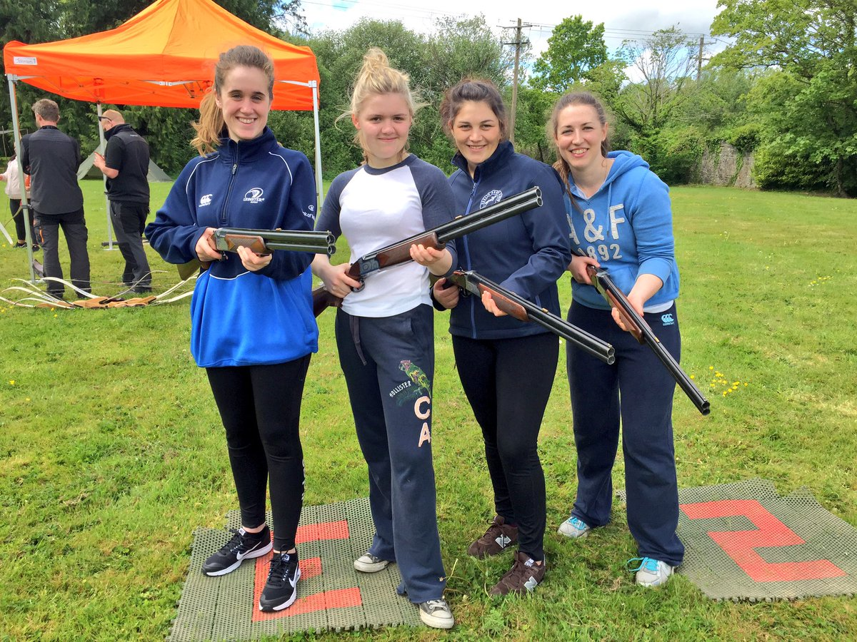 Delegates smiling with their guns taking part in some clay pigeon shooting