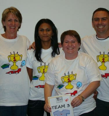 Delegates showing off their t-shirts during Orangeworks team bonding challenge T-Shirt Masterpiece.