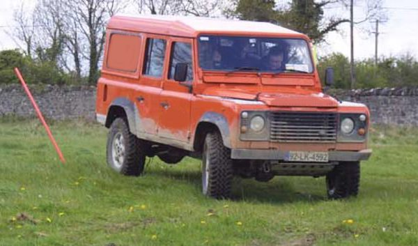 Orange Landrover Defender driving the 4x4 Blindfold Driving obstacle course with Orangeworks.