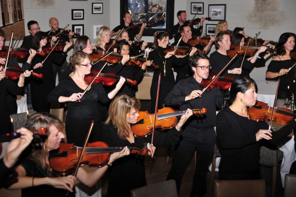 Delegates joined together, holding their violins for the finale performance to show what they've learned during Orchestrate.