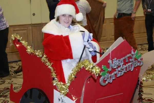 Delegate sitting in sleigh dressed as Santa