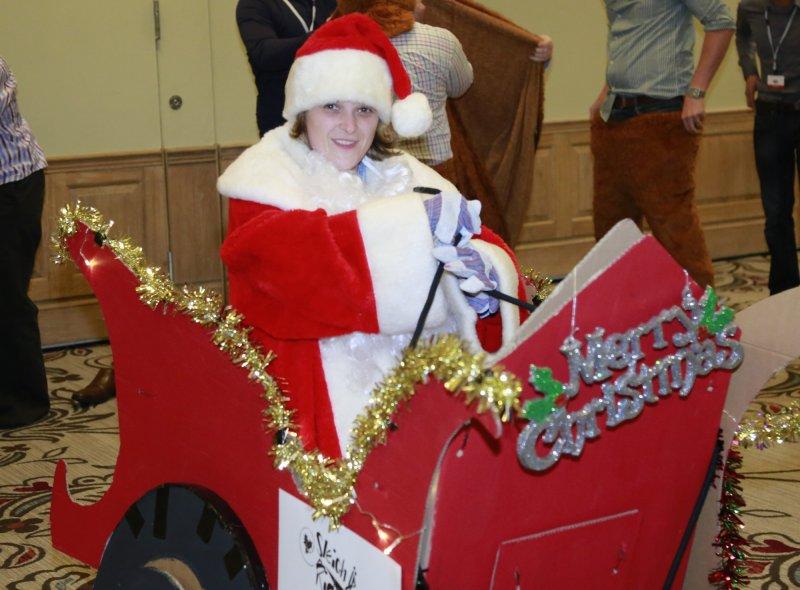 Delegate sitting in sleigh dressed as Santa