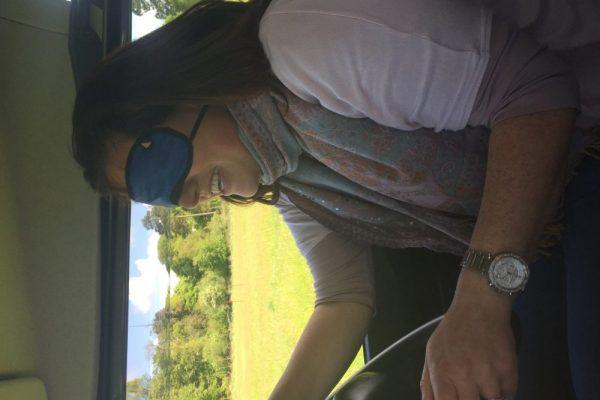 Blindfolded delegate driving an Orangeworks defender during her team building experience.