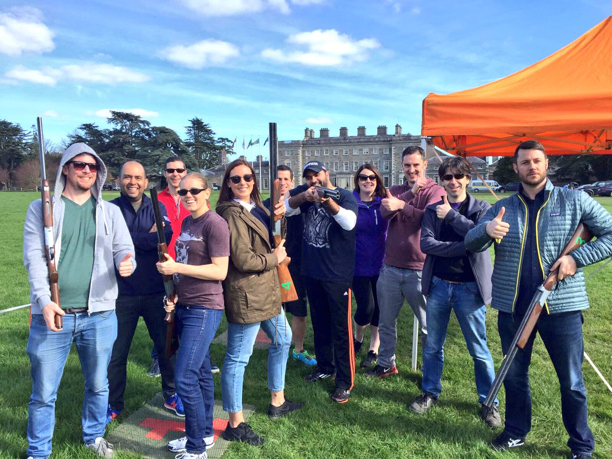 Delegates smiling for a photo after laser clay pigeon shooting