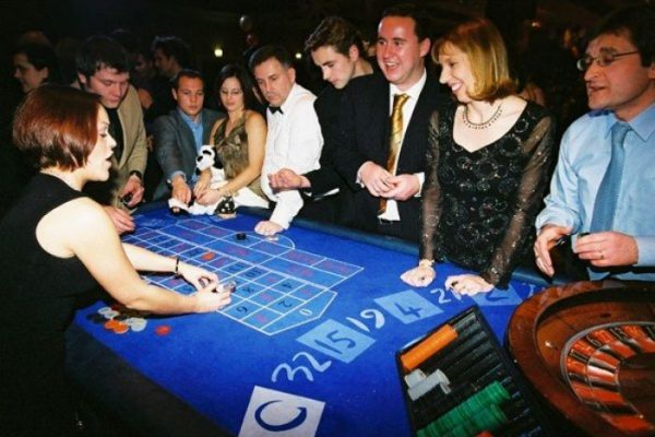 Delegates placing bets at the casino table