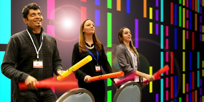 Delegates use their boom whackers to the beat of the music