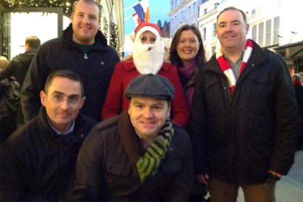 Team standing, with a delegate dressed as Santa, during Orangeworks Go Team Santa Claus interactive based Treasure Hunt.