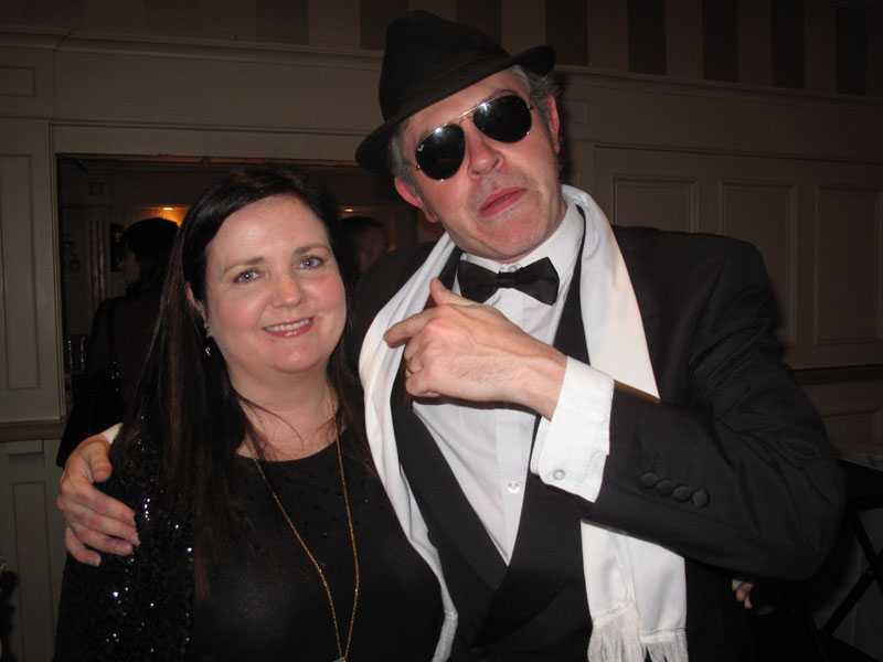 Murder Mystery actor getting in a picture with a delegate