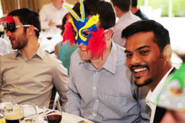Delegates are given some masks to wear over dinner