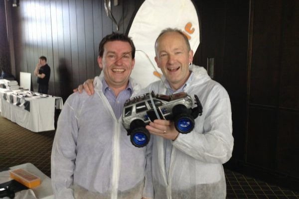 Delegates smiling with remote controlled car