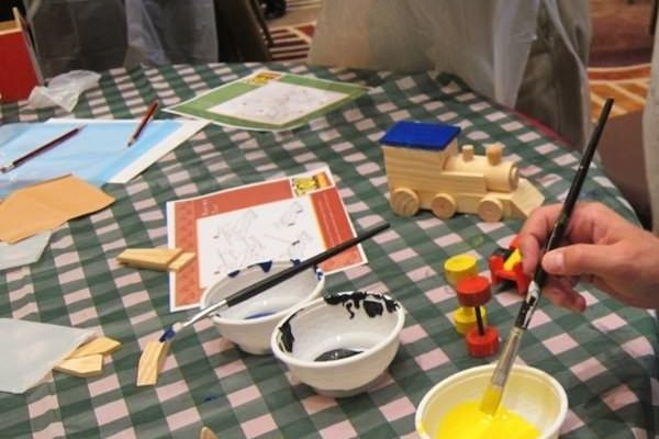 Painting wooden toy cars and trains