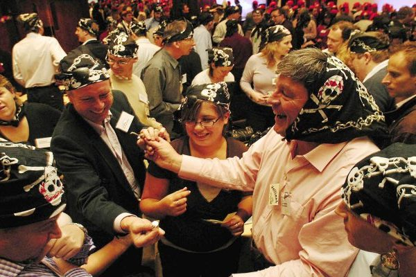 Delegates trading in pirate costume during Trade Winds game