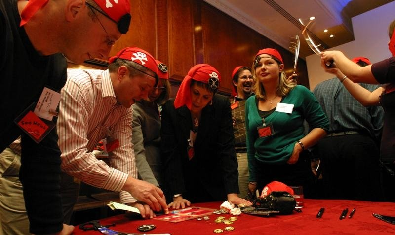 Delegates in pirate costume working together at table