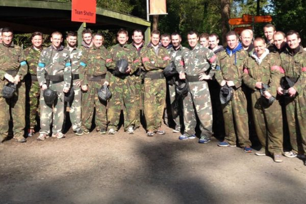 A team wearing army overalls, about to start Delta 2 Bravo, an outdoor team building game hosted by Orangeworks.