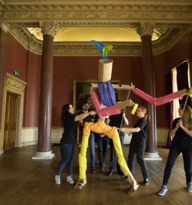 Teams moving their puppet around a room