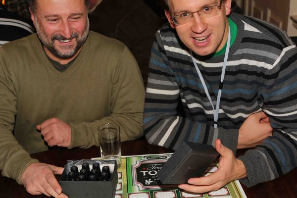 Two delegates smile with their box of gin tasters