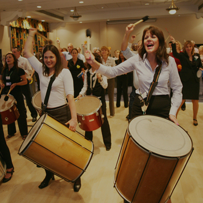 Delegates drumming during Beatswork finale