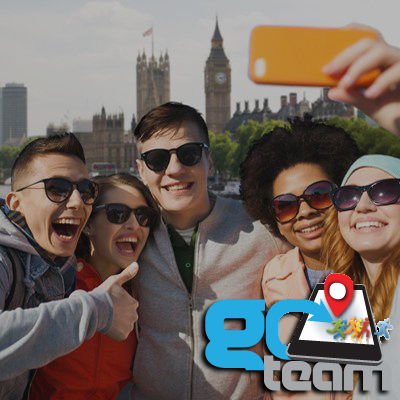 Happy group taking a selfie in London with Big Ben behind them during Go Team treasure hunt