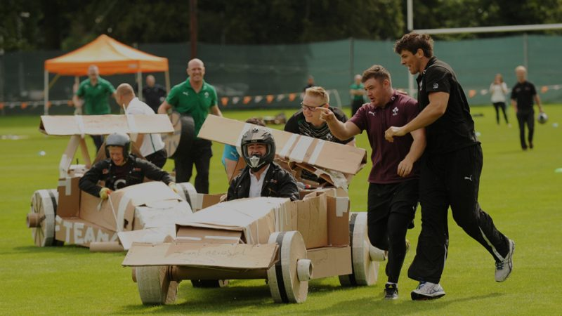 Delegates racing against each other during the innovative team bonding activity Flat Out Formula One by Orangeworks