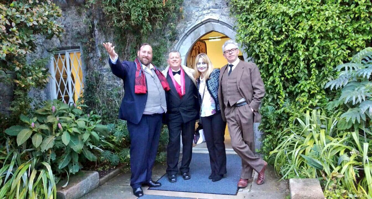 Murder Mystery actors standing outside hotel before event