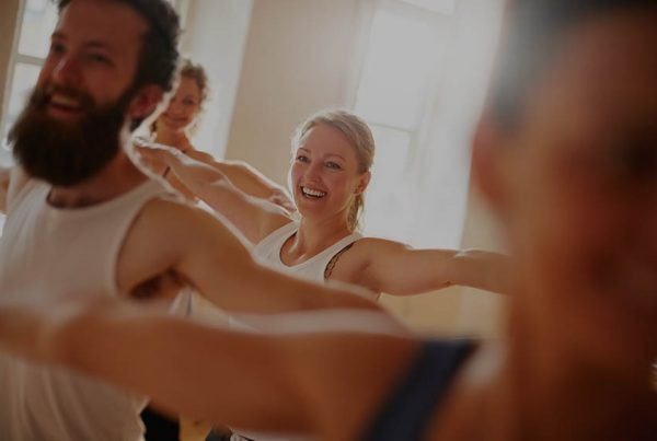 Cropped shot of a group of people attending a yoga class
