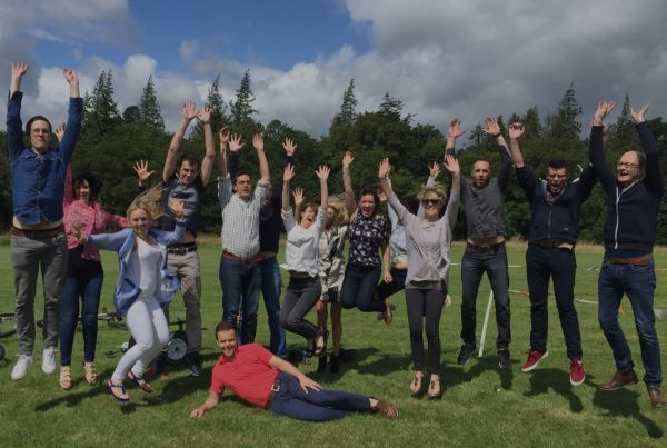 Happy group jumping in the air