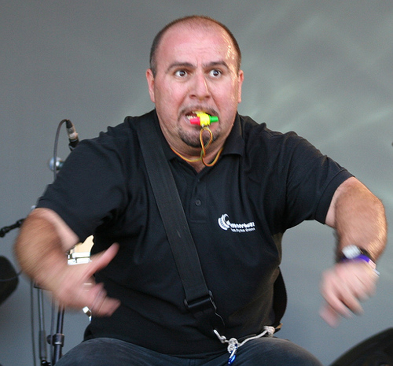 Ed Freitas, Orangeworks main haka instructor, with a whistle in his mouth while teaching delegates the haka.
