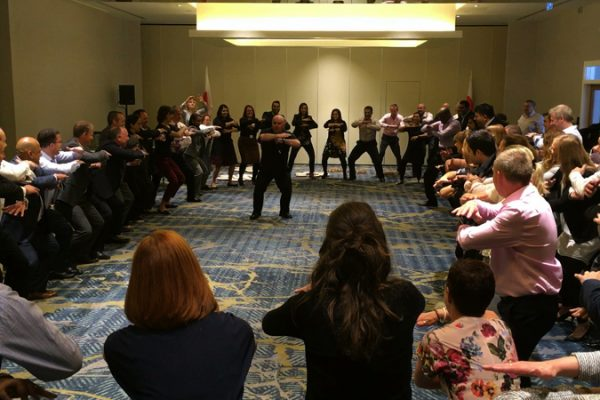 Ed Freitas teaching delegates how to do the haka, a fun corporate conference energiser experience.