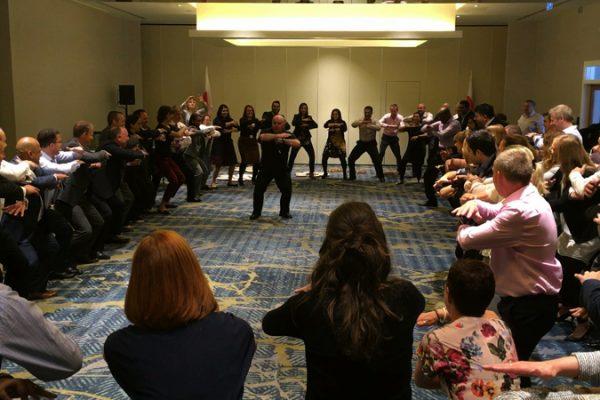 Ed Freitas teaching delegates how to do the haka, a fun corporate conference energiser experience.
