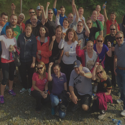 Happy group after their corporate sports day event in London with Orangeworks.