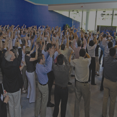 Delegates come together with arms in the air for the One Voice finale.