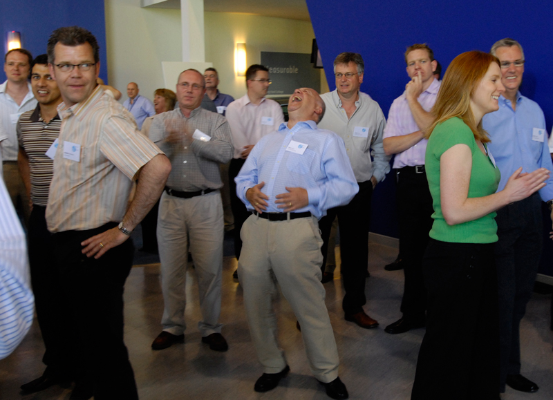Participants of One Voice, the corporate conference energiser ran by Orangeworks, laughing and dancing together.