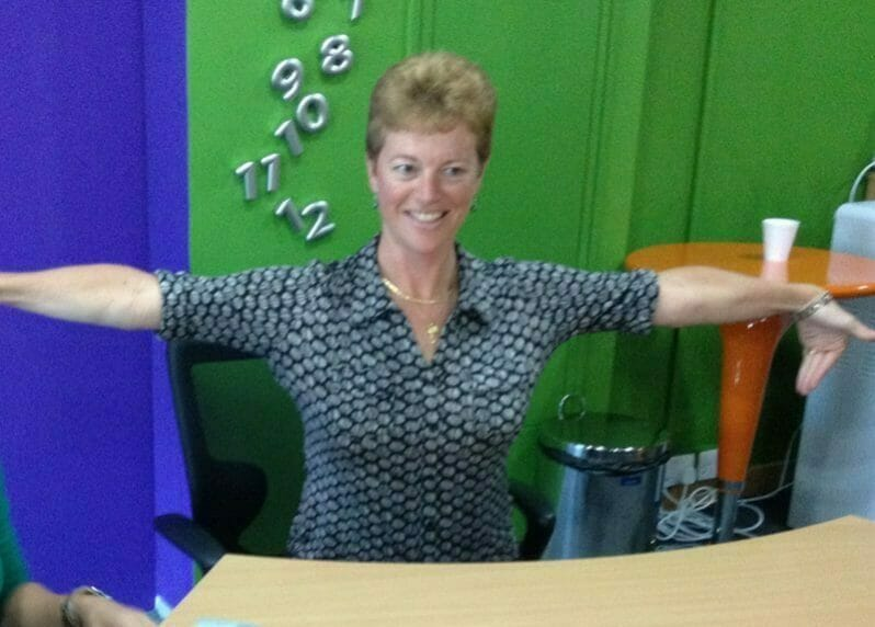 Delegate stretching her arms during Head to Toe, a mindfulness team-building activity hosted by Orangeworks.