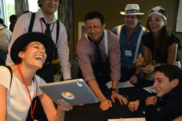 Team laughing together during Escape the Mob, an escape room style team game by Orangeworks.