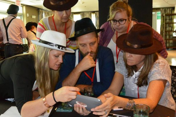Teams work together to solve clues during Escape the Mob, a team building activity by Orangeworks.