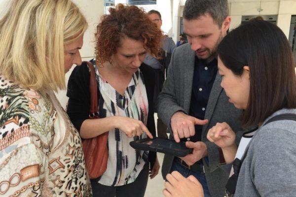Team checking their iPad during their bespoke treasure hunt