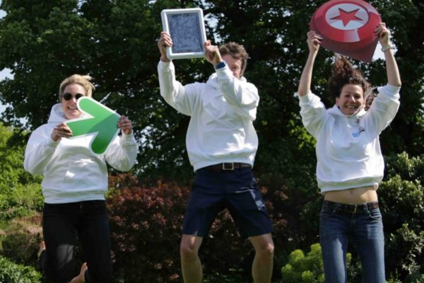 Happy team jumping in the air on their Go Team Bespoke Challenge