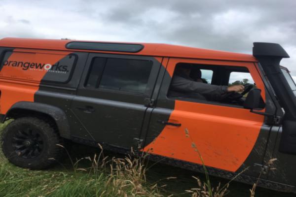 an Orangeworks vehicle in a field