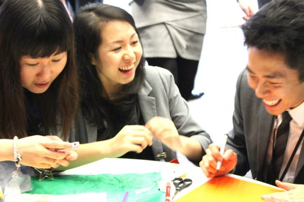 Delegates laughing as they create their animation with Orangeworks, as part of their corporate away day activities.