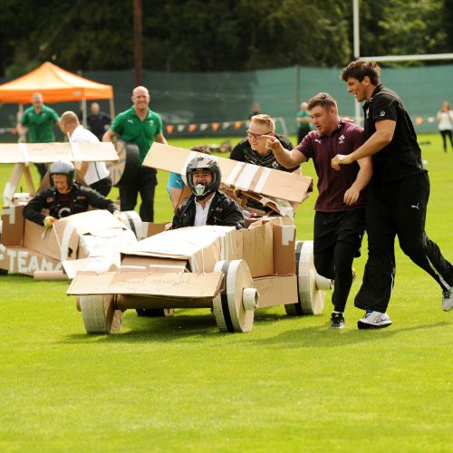 Delegates race their cardboard formula one cars that they built as part of their fun team-building activity for work.