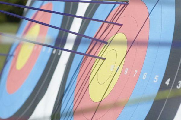 Archery target with arrow, one of Orangeworks outdoor team building activities.