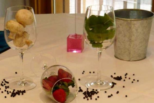Strawberries, mint and mushrooms in wine glasses